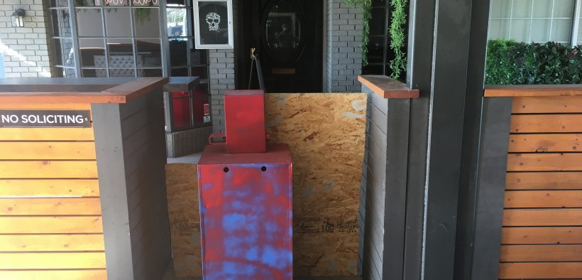Makeshift barriers blocked entry to Whiskey Tango Foxtrot, a West El Paso bar that had its liquor license suspended for violating COVID-19 health orders. (Robert Moore/El Paso Matters)